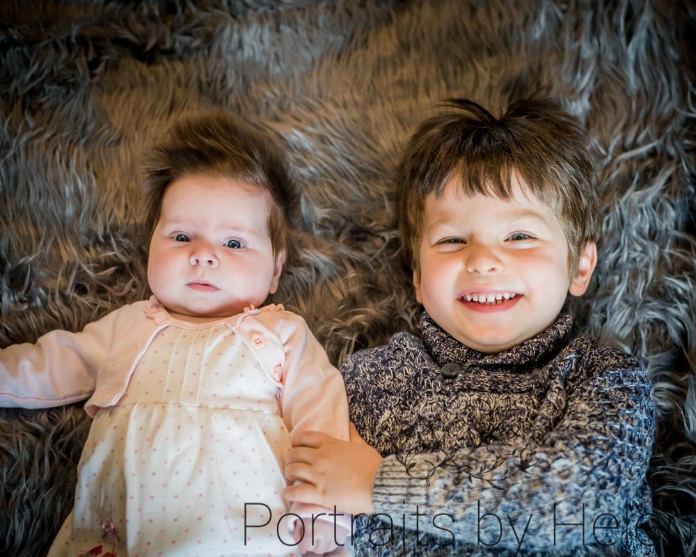 Smiling siblings, newborn photographer Cumbria