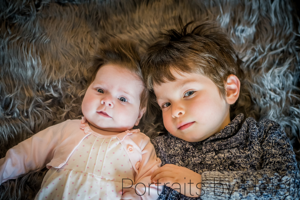 Holding hands with sister, newborn photographer Cockermouth