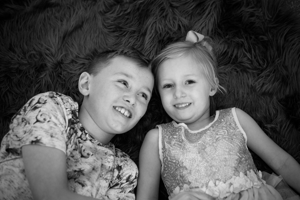Snuggles siblings, baby photographer Workington