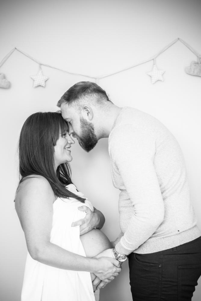 Kisses with husband, maternity photographers Cumbria