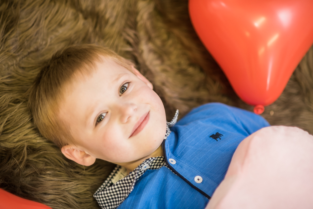 Lying in heart shaped balloons, Carlisle child photographer