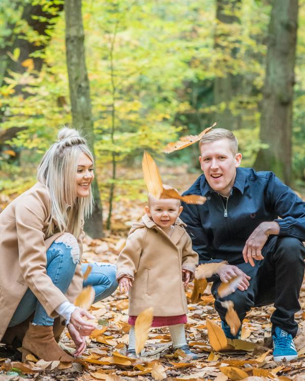 Leaf throwing family photographs, Cumbria