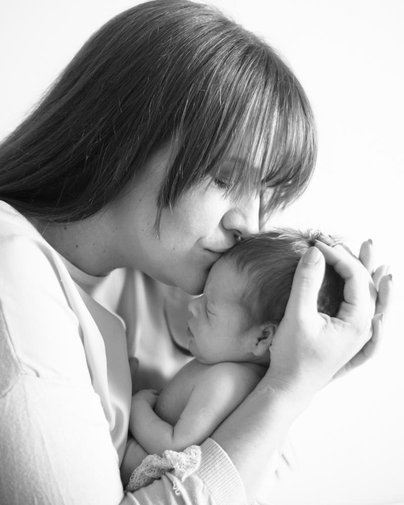 Mum kissing Archie, newborn photographer Workington