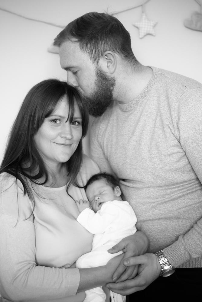 Cuddles with family - newborn photographer Carlisle