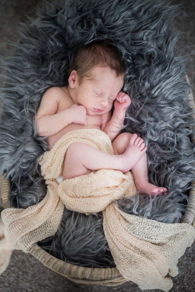 Curled up Archie, baby photographer Cumbria