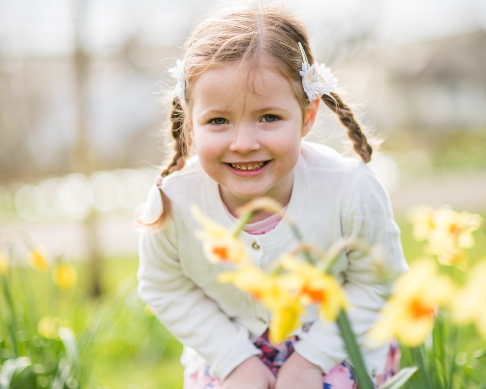 Delilah sniffing daffodils, Cockermouth baby photographer