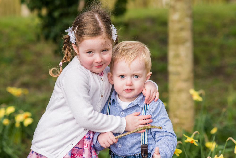 Sibling cuddles, daffodil photographs Cockermouth