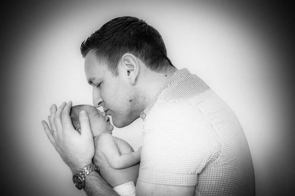 Dad kissing baby, newborn photographs Carlisle
