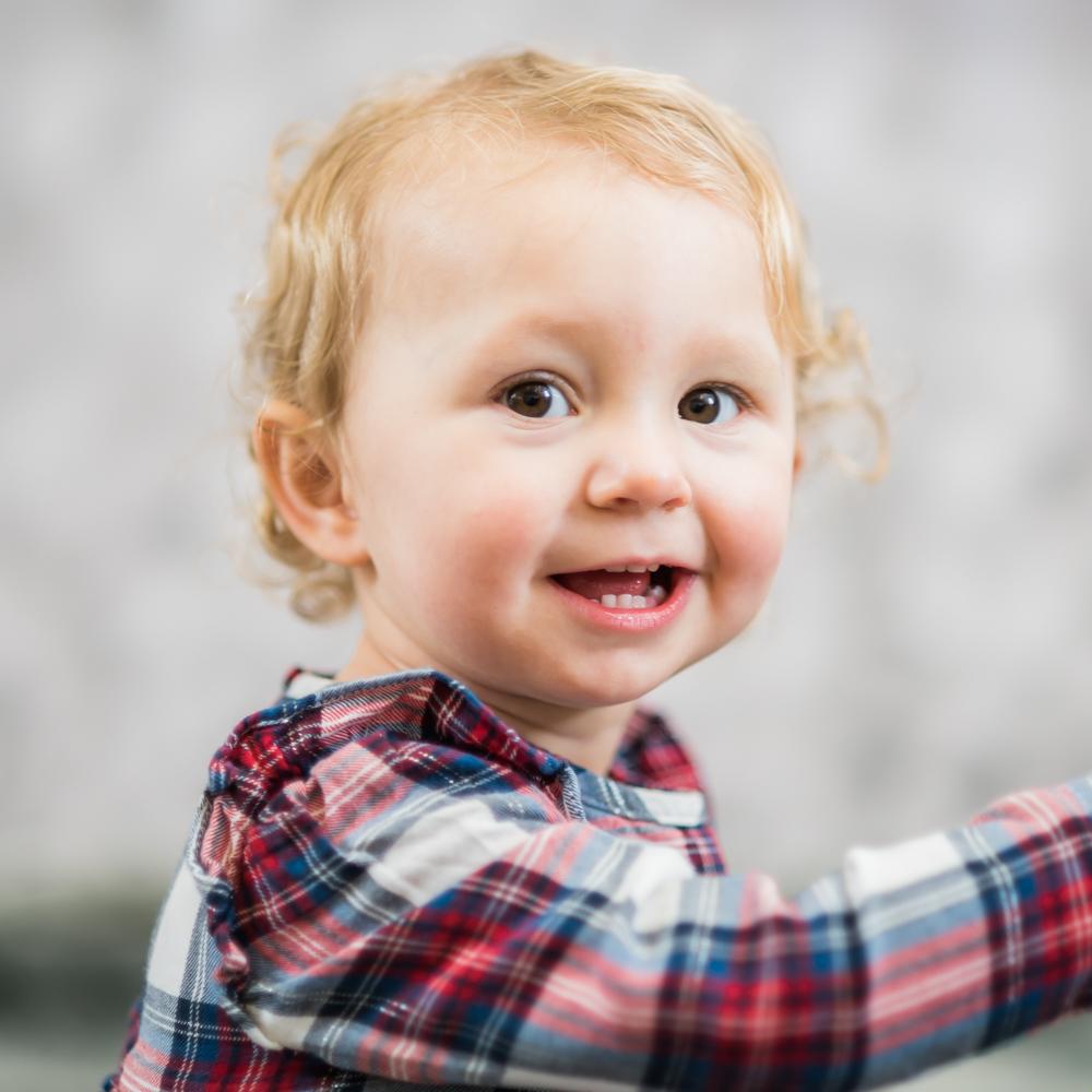 Cheeky face, baby photographer Cumbria