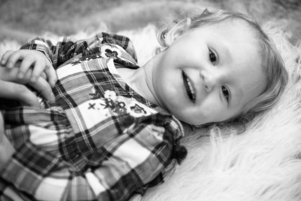 Lying on rug, baby photographer Carlisle