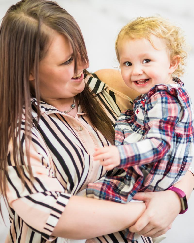 Laughs with Mum, newborn photographer Cumbria