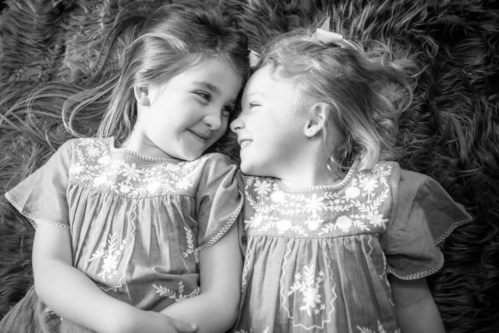 Sister laughs, baby photographer Aspatria