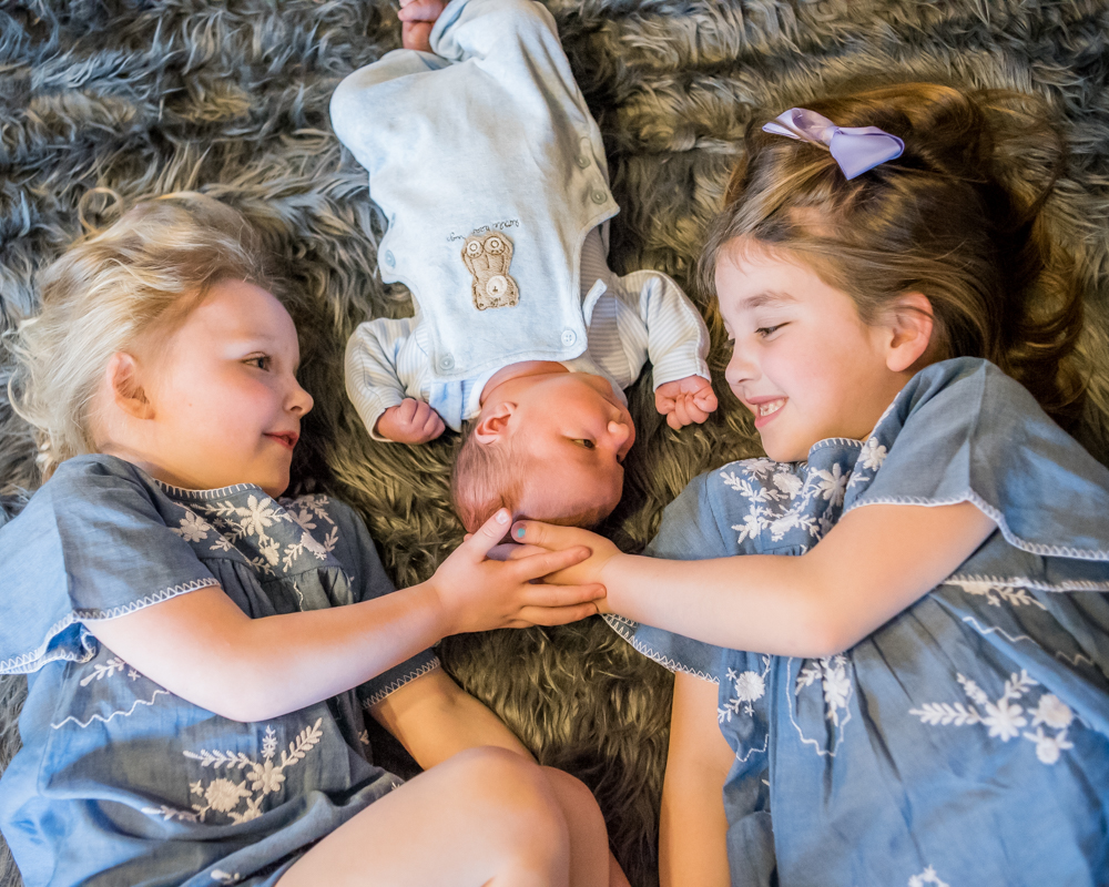 newborn photographers Cockermouth, sibling cuddles