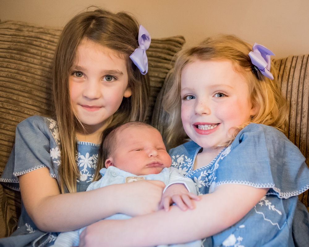 Sister cuddle, newborn photographer Drigg