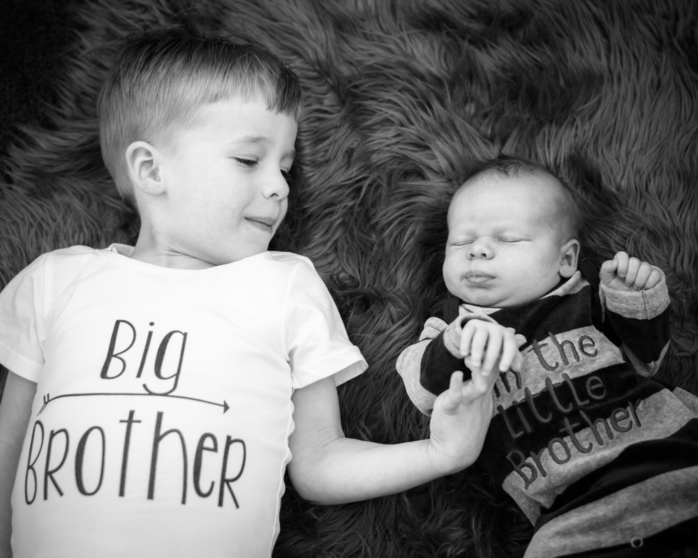 Brothers holding hands, baby photographers Cockermouth