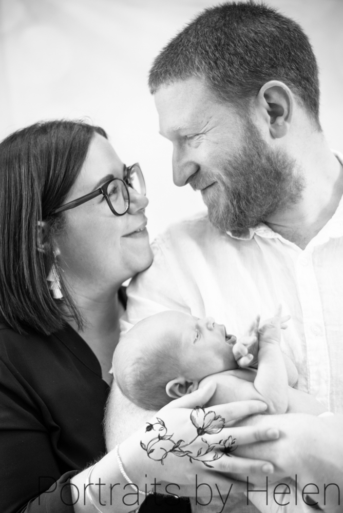 family cuddles with baby, newborn photographer Cockermouth