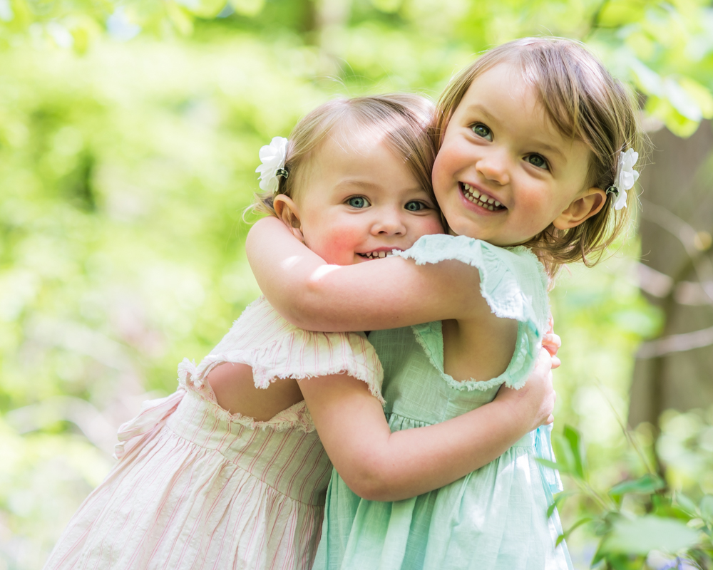 Sister cuddles, woodland portrait photos
