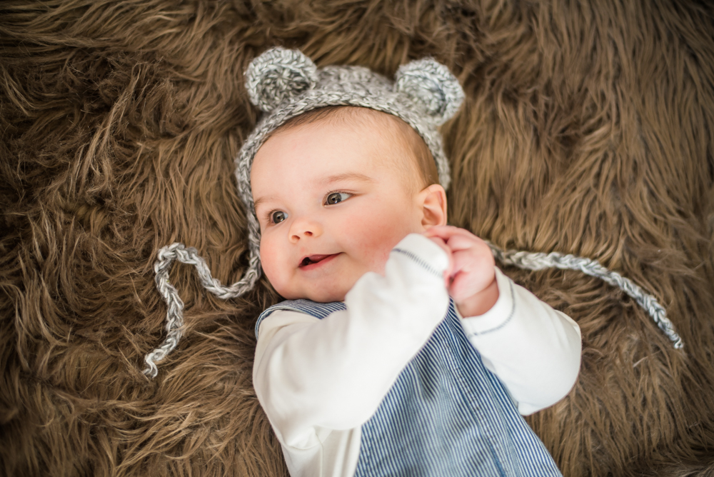 Smiling in teddy hat, Cockermouth newborn photographer