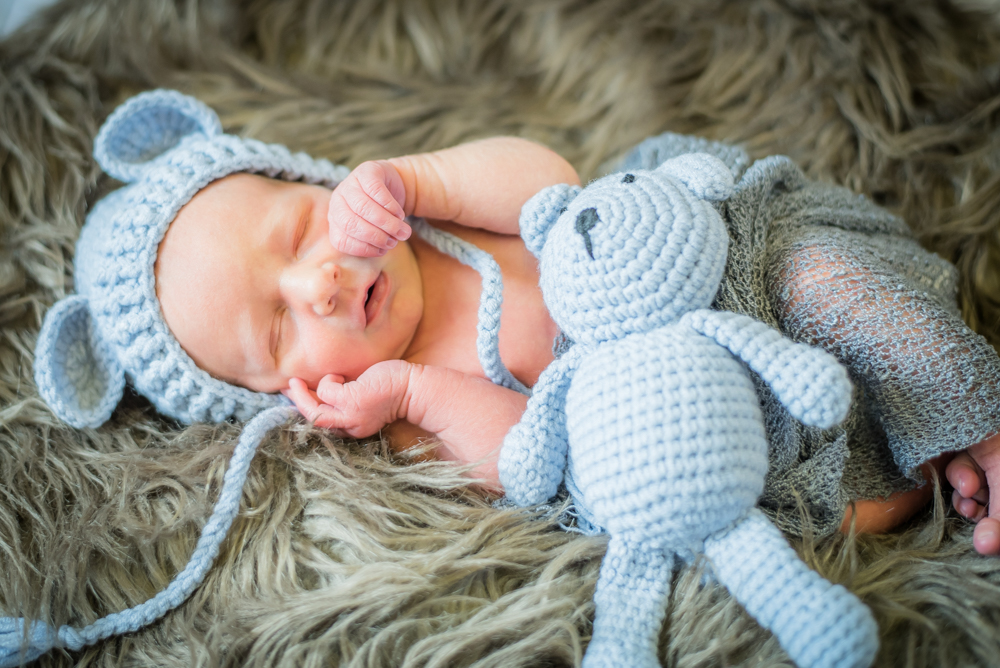 Newborn Michael with a teddy - baby photographer Cockermouth