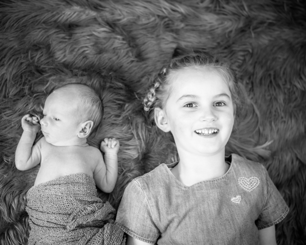 Baby and sister smiles, newborn portraits Carlisle