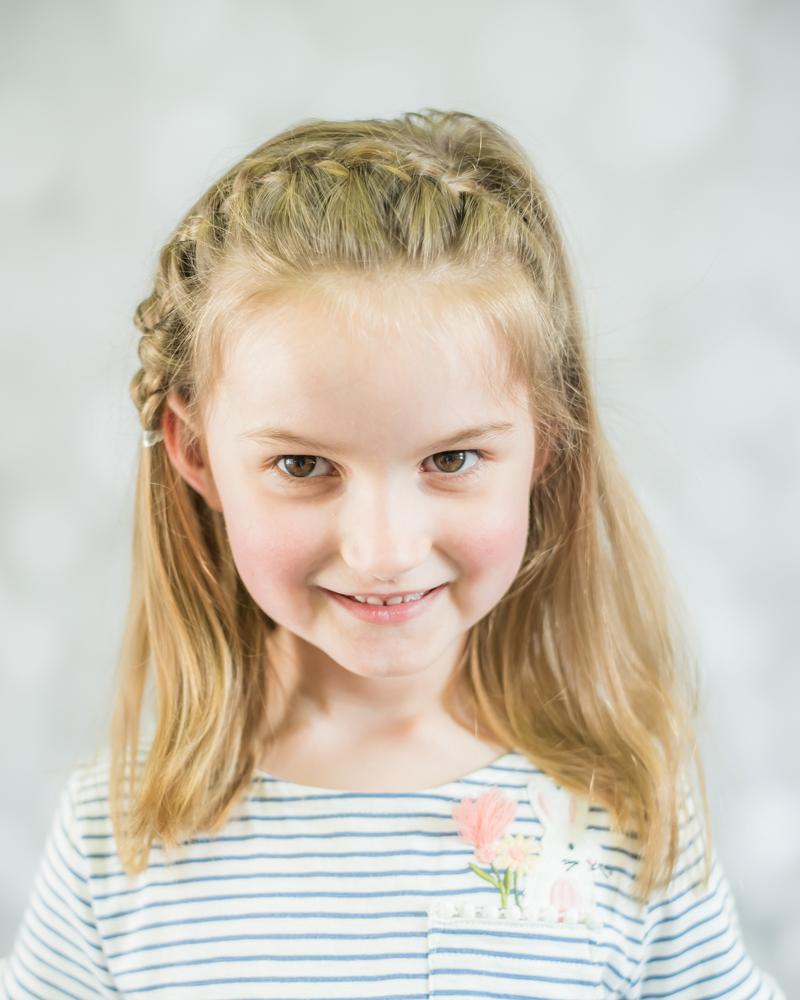 Big sister smiles, photographers Carlisle