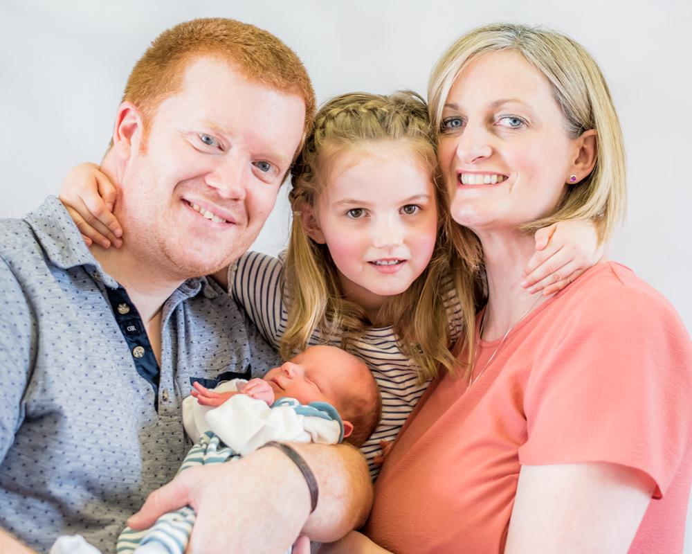 Family cuddle, baby photographer Aspatria