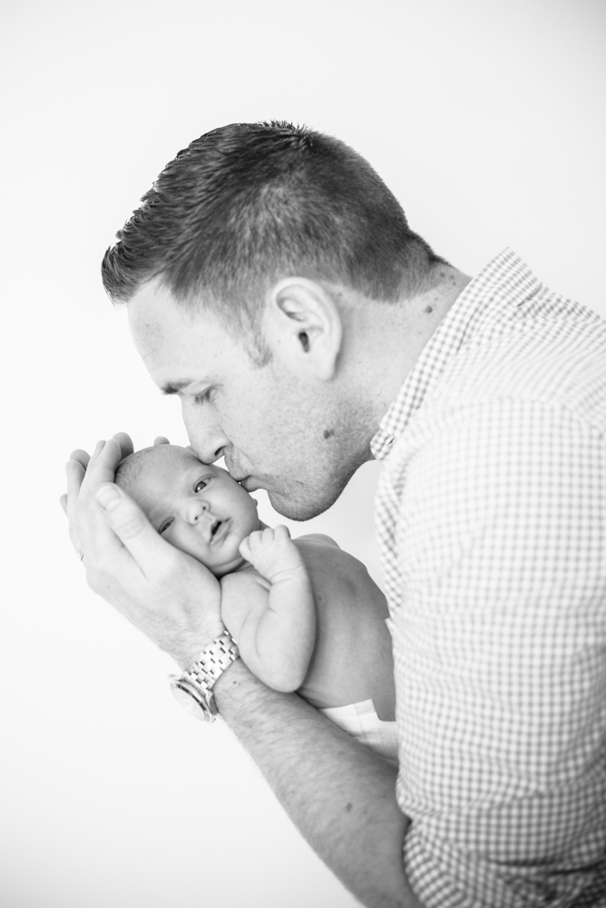 Dad and baby kisses, newborn photographer Keswick