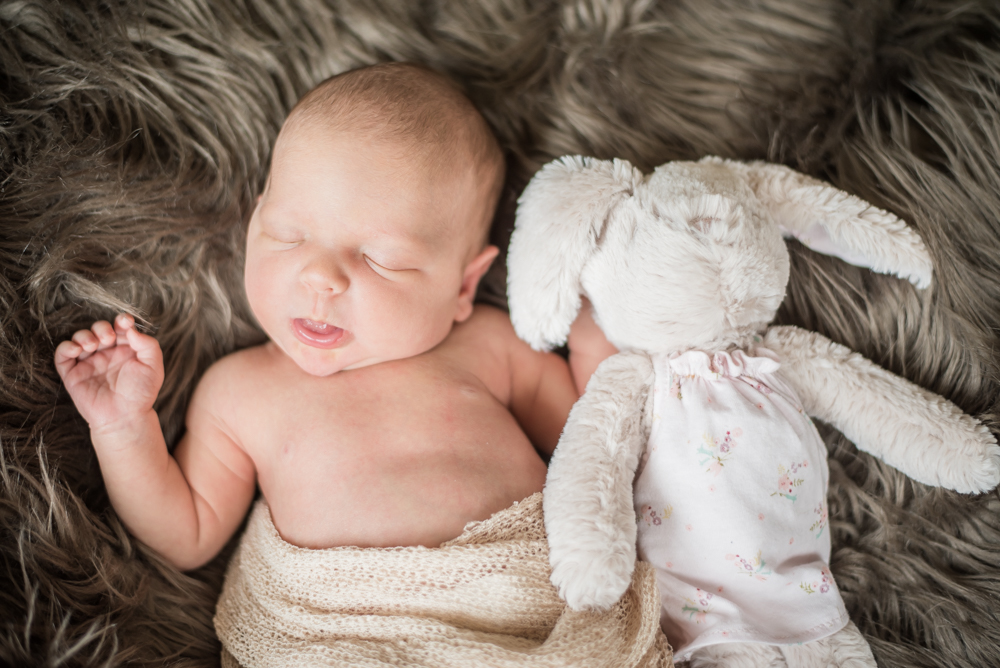 Baby Georgie and her rabbit toy, newborn photographers in Maryport