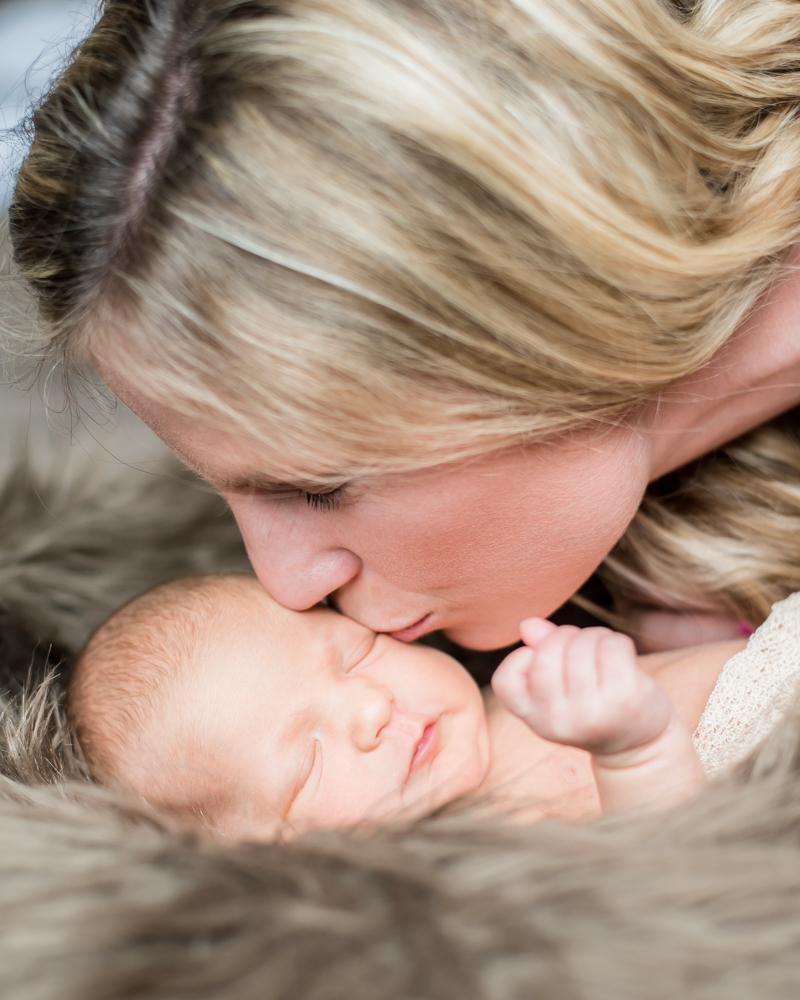 Mum kissing baby, newborn photographer Cockermouth