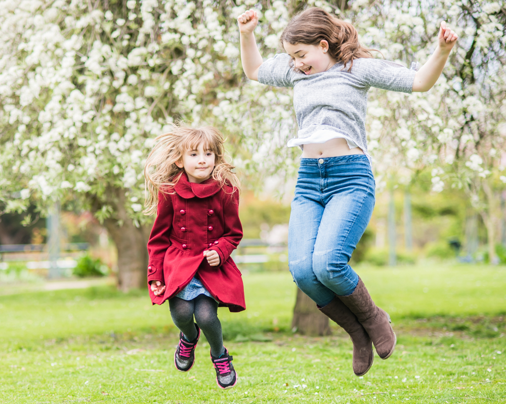 Jumping for joy - Connie and Gina in Botanical Gardens