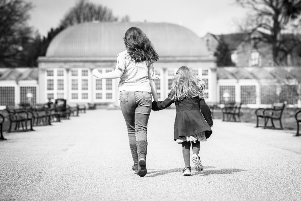Sisters walking away from camera, Sheffield Botanical Gardens