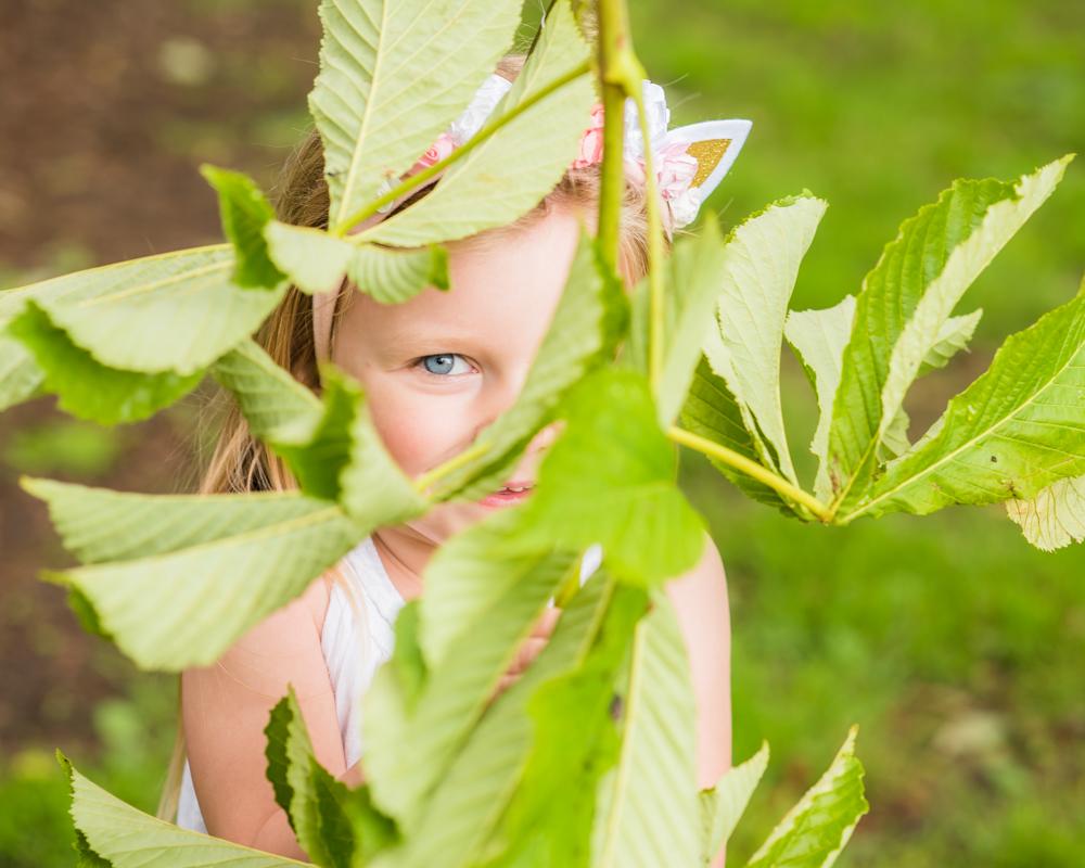 Katie hiding behind leaf, Bitts Park, Carlisle