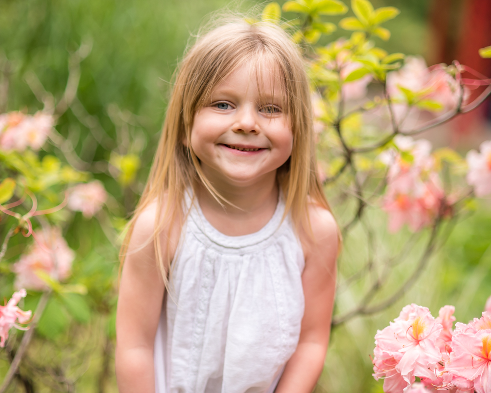 Katie hiding in flowers, Carlisle family photographers