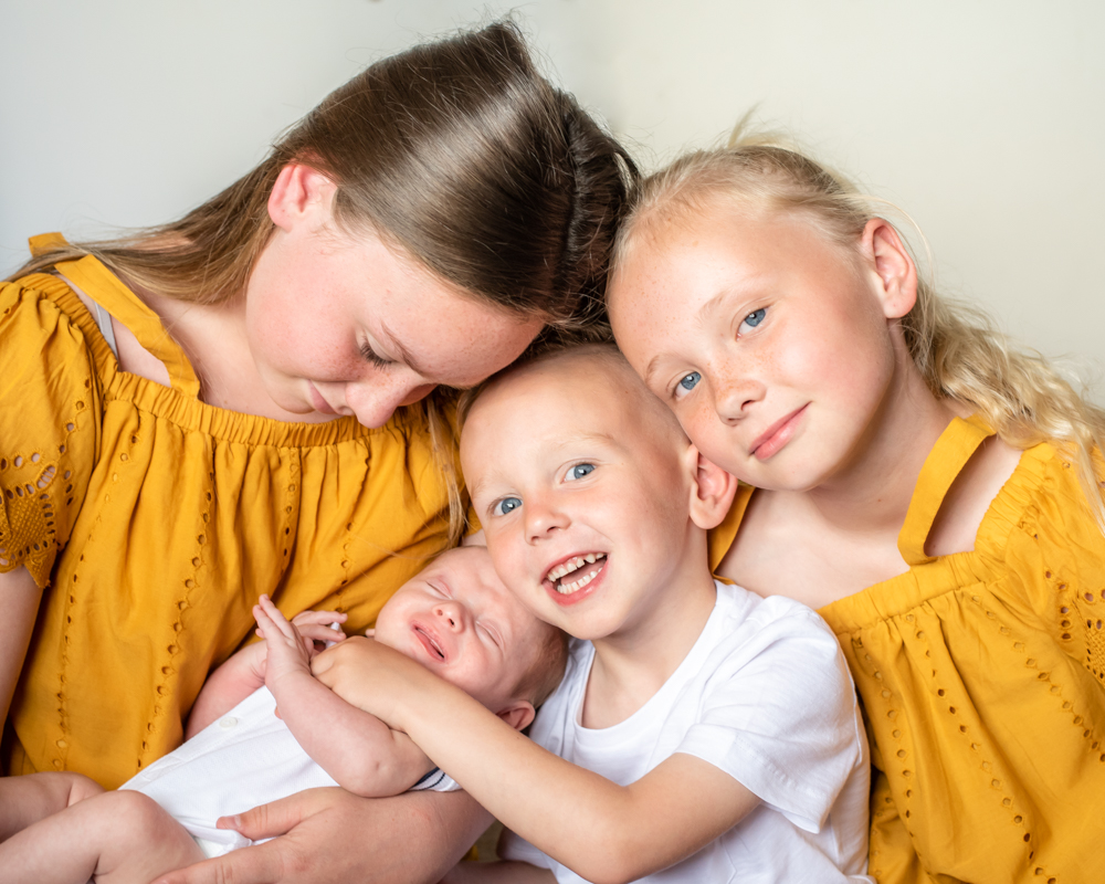 Cuddles with his siblings, Carlisle photographer