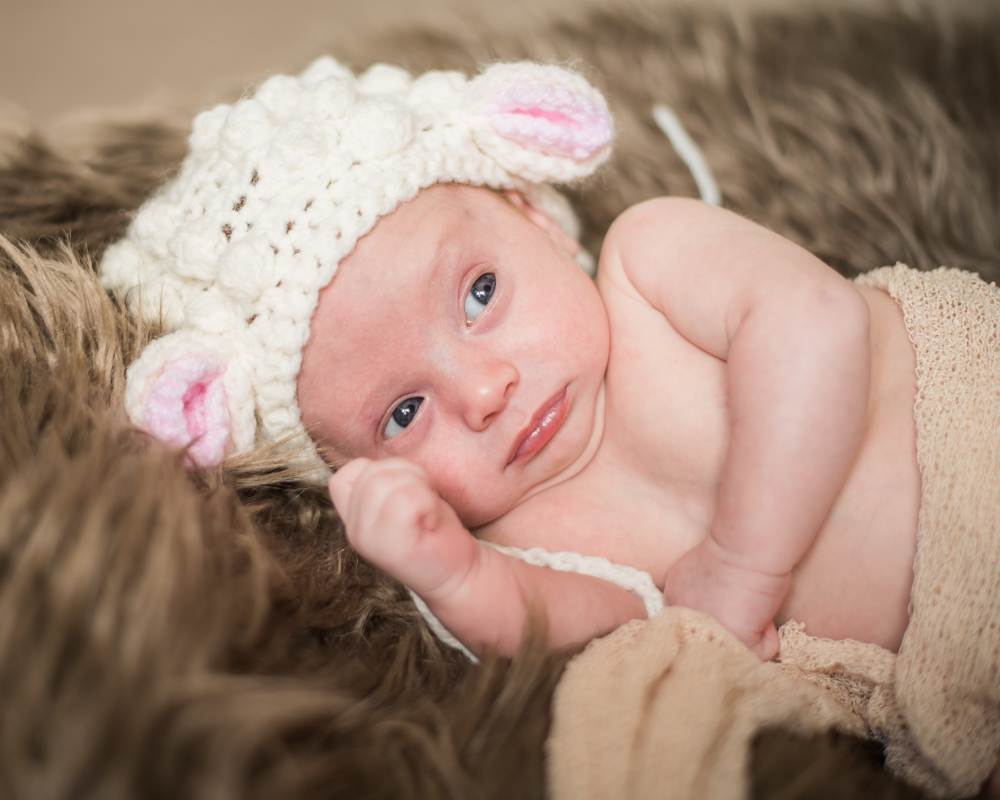 Chester in lamb hat - newborn portraits Workington