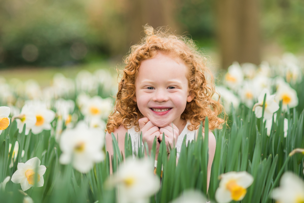 Peeping through daffodils, Keswick baby photographer