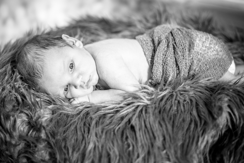 Black and white lying down portraits, baby photographer Wigton