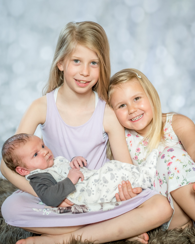 Cradling baby brother, studio baby portraits Wigton