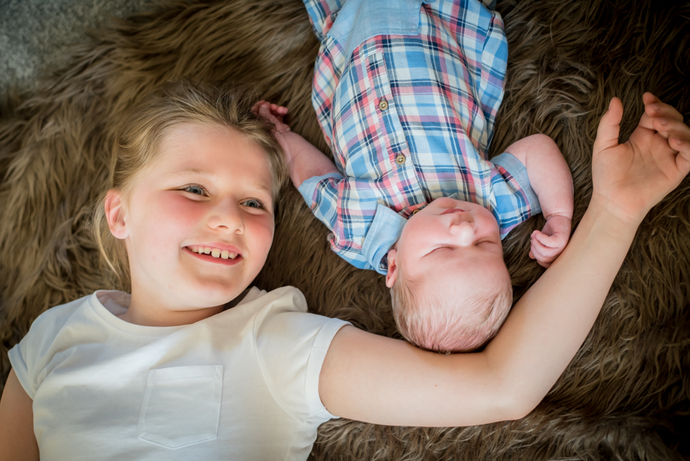 Smiling big sister and baby, newborn photography Bothel