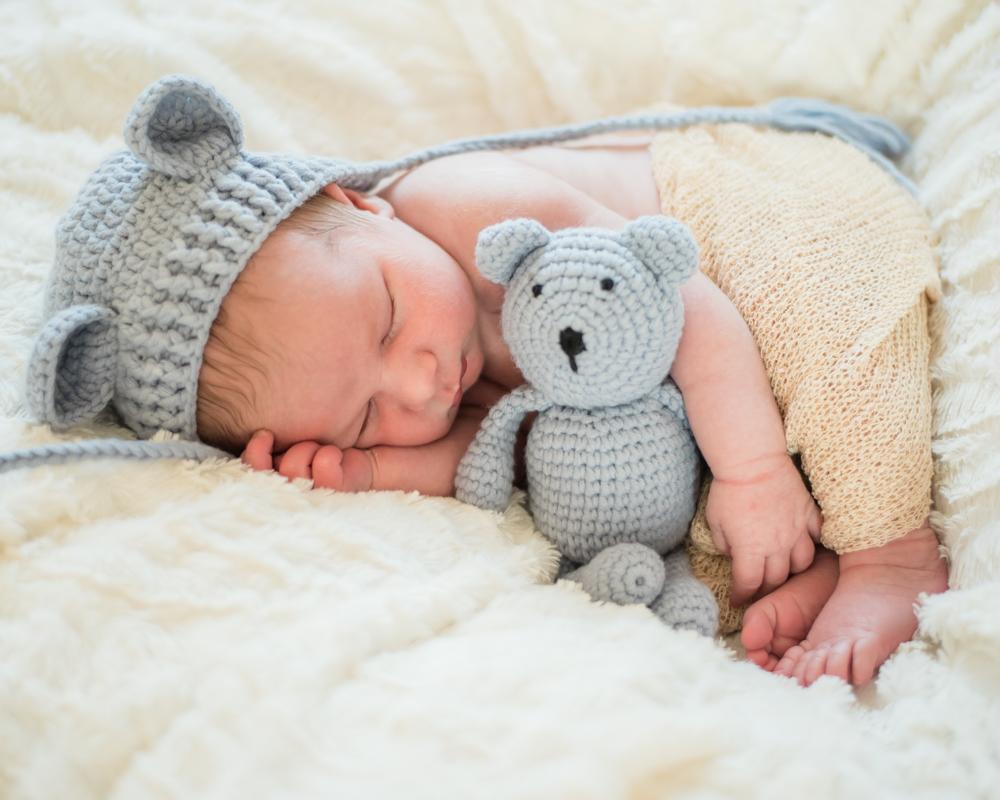 Baby Austin holding teddy with cute hat, baby photographers Aspatria