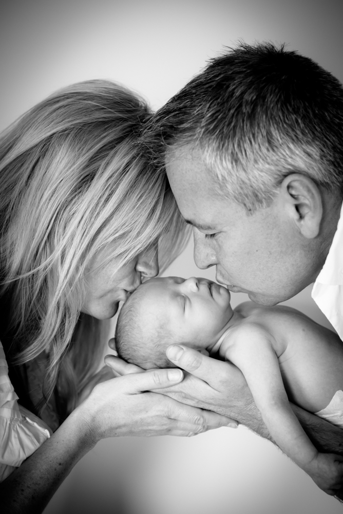 Mum & Dad kissing baby Rory, baby photographers Wigton