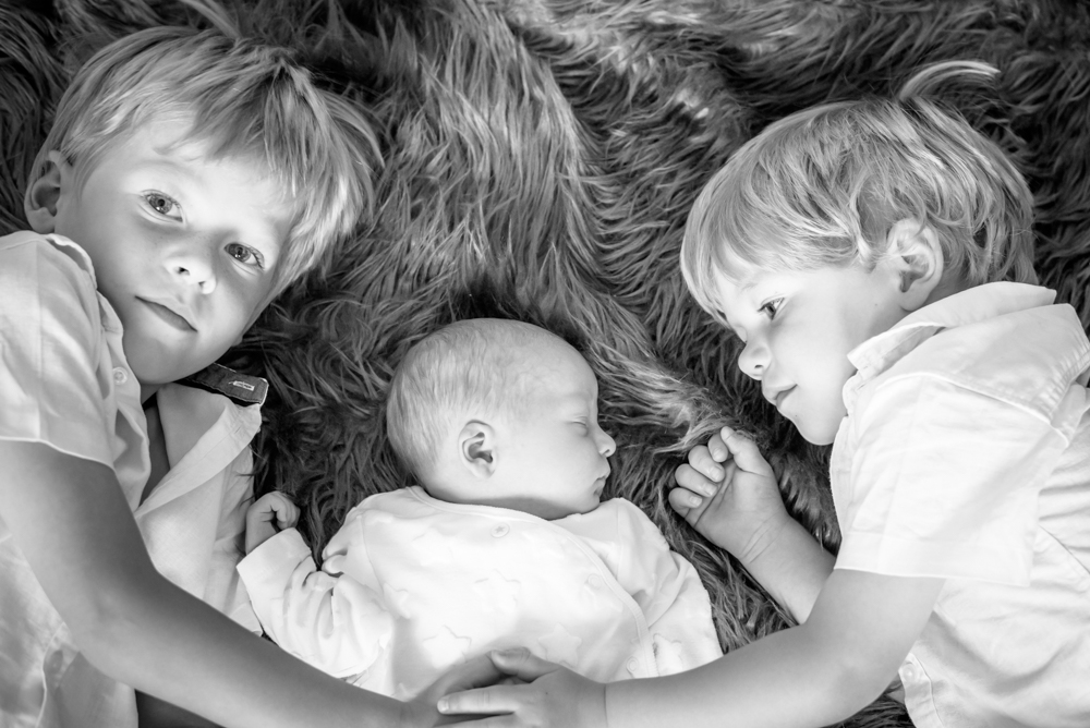 Cuddles for baby brother, baby photographer Wigton