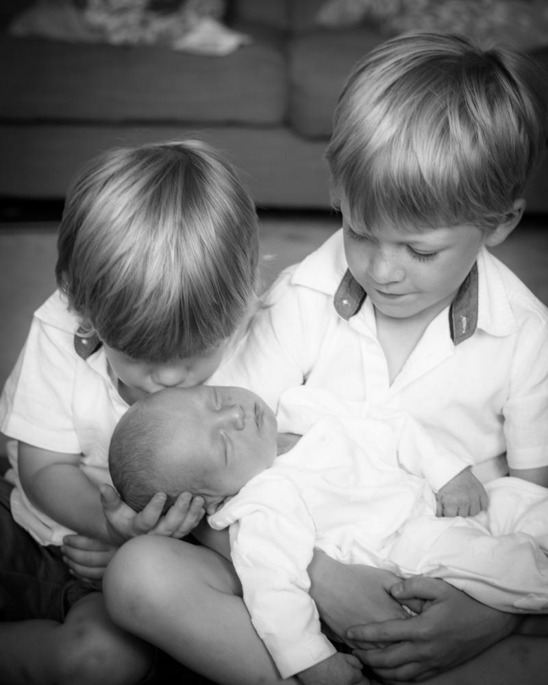 Kiss for baby brother, newborn photographer Keswick