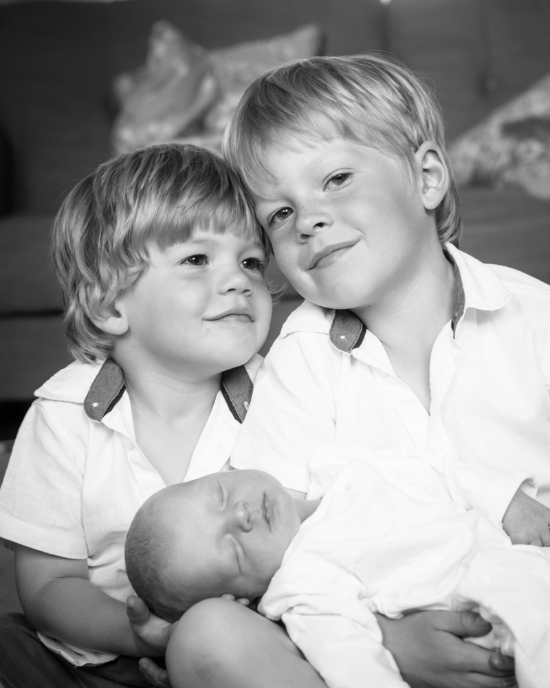 Snuggles with big brother, newborn photographer Cockermouth
