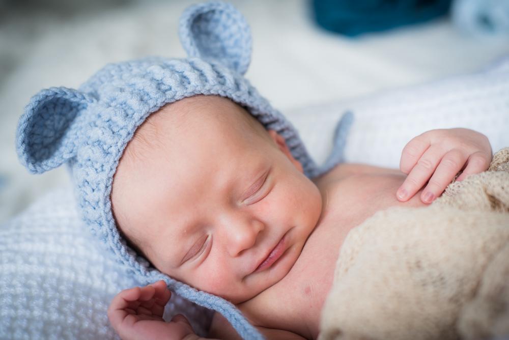 Smiling with teddy hat, newborn photographer Carlisle