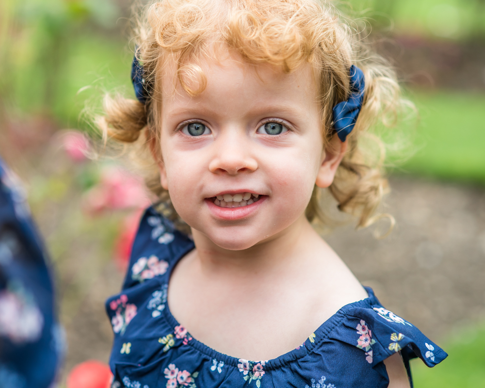 Curly girl, photographs in Rose Garden, Carlisle baby photographers