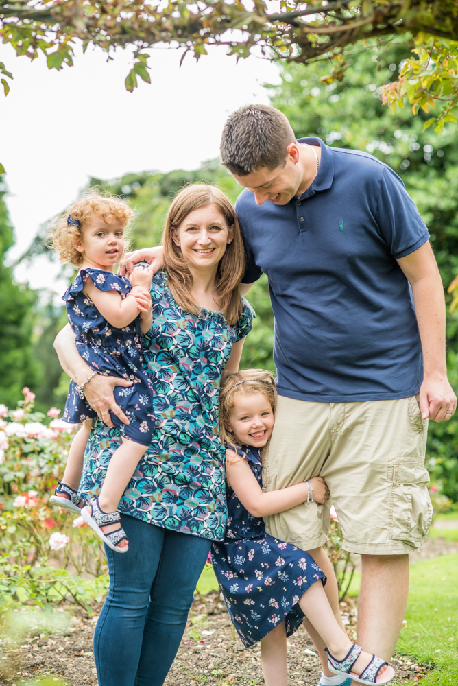 Family cuddles with Mum & Dad, Wigton baby photographers