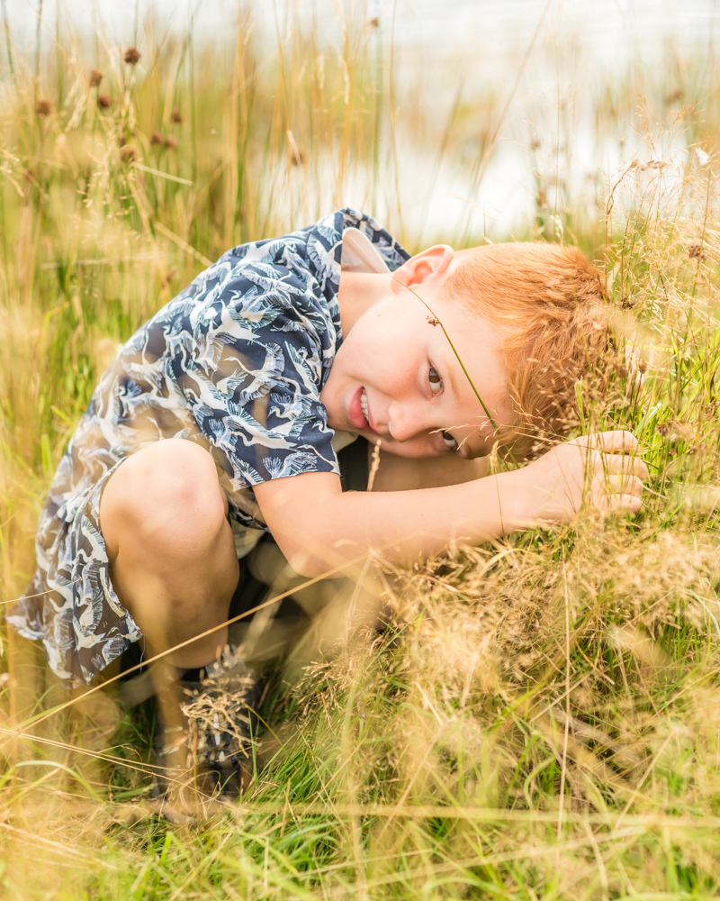 Hiding in the long grass, baby photographer Carlisle