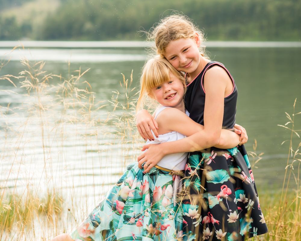 Sisterly cuddles, Lake District baby photographers