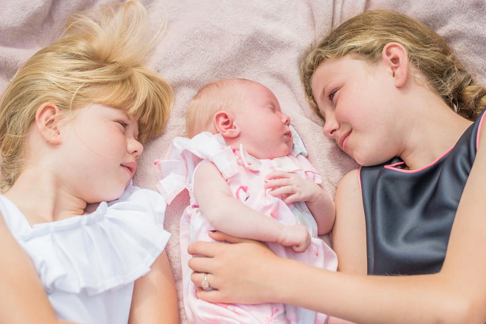 All looking at Beatrix, newborn photographer Carlisle